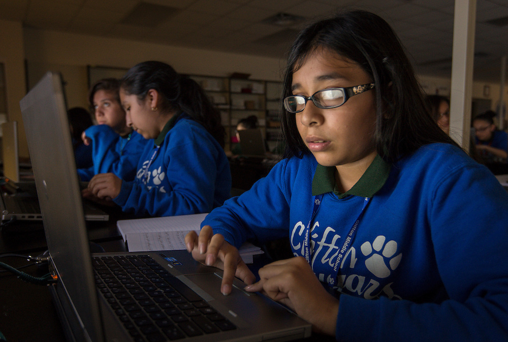 Students work on a worldwide computer security legal hacking challenge at Clifton Middle School, November 6, 2014.
