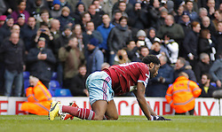 West Ham's Alexandre Song on his knees after conceding a penalty - Photo mandatory by-line: Mitchell Gunn/JMP - Mobile: 07966 386802 - 22/02/2015 - SPORT - football - London - White Hart Lane - Tottenham Hotspur v West Ham United - Barclays Premier League