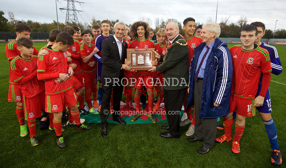 NEWPORT, WALES - Thursday, November 5, 2015: Wales' Elite Performance Director Ian Rush' and Mayor of Newport Herbie Thomas present the trophy to Wales' captain Ethan Ampadu after the Under-16's Victory Shield International tournament at Dragon Park. (Pic by David Rawcliffe/Propaganda)