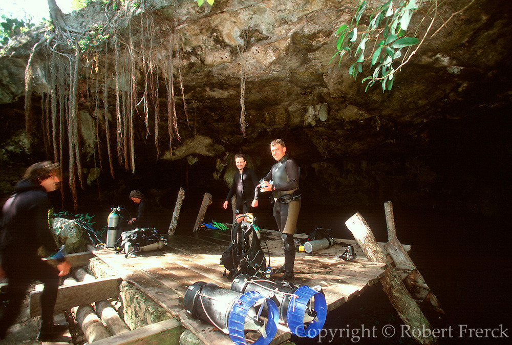 MEXICO, YUCATAN, TOURISM scuba divers at 'Dos Ojos Cenote'