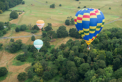 © Licensed to London News Pictures. 08/08/2019; Bristol, UK. Morning mass ascent of over 50 balloons at the 41st Bristol International Balloon Fiesta 2019 which takes place from 08 - 11 August 2019. For the first time in the event's history the first mass ascent of the fiesta was brought forward a day early due to the forecast for bad weather on Friday and Saturday. The Bristol International Balloon Fiesta attracts hundreds of thousands of visitors and this year the Fiesta will be celebrating Icons of Bristol and look to highlight some of the things that make up the home of the International Balloon Fiesta. The event has joined forces with Aerospace Bristol to honour one of the city's most famed creations, Concorde and Aardman Animations who are celebrating the 30th anniversary of Wallace and Gromit. Photo credit: Simon Chapman/LNP.