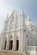 "Velankanni also known as Vailankanni or ""Velanganni"", is a town in Nagapattinam district in the Indian state of Tamil Nadu. It is a small town located on the shores of the Bay of Bengal 350 km south of Chennai (Madras) and 12 km south of Nagapattinam on the Coromandel Coast, in Tamil Nadu, India. The site of an important Roman Catholic shrine dedicated to Our Lady of Good Health. Our Lady of Vailankanni, also known as the ""Lourdes of the East,"" is one of the most frequented religious sites in India. Vailankanni church was built in the late 16th century CE with modifications by Portuguese and further expansions later on due to influx of pilgrims. The Gothic style of architecture is a unique feature of the church."