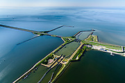 Nederland, Friesland, Gemeente Wonseradeel, 07-05-2018; Afsluitdijk ter hoogte van Kornwerderzand. Op het voormalig werkeiland liggen de Lorentzsluizen, een complex van spuisluizen en schutsluizen. De spuisluizen (uitwaterende sluizen) lozen van het IJsselmeer op de Waddenzee (boven). De sluizen worden beschermd door kazematten (bunkers). <br /> Enclosure Dam at the height of Kornwerderzand. On the former work island the Lorentz locks, a complex of sluices and locks. The sluices sluice surplus water to the Wadden sea (top). The locks are protected by bunkers.<br /> luchtfoto (toeslag op standard tarieven);<br /> aerial photo (additional fee required);<br /> copyright foto/photo Siebe Swart