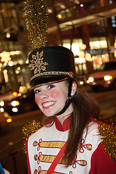 North America, United States, Washington, Bellevue, female drummer at Snowflake Lane holiday celebration in downtown Bellevue
