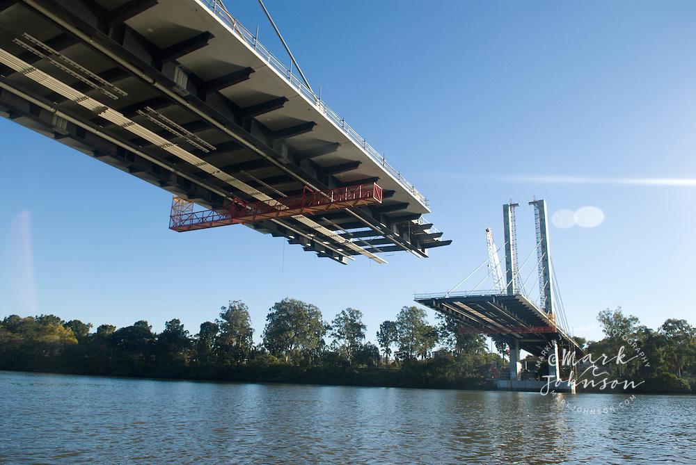 Eleanor Schonell Bridge under construction across the Brisbane River between Dutton Park & The University of Queensland, Brisbane, Queensland, Australia