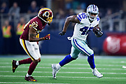 ARLINGTON, TX - NOVEMBER 22:  Rod Smith #45 of the Dallas Cowboys runs the ball and is chased by Quinton Dunbar #23 of the Washington Redskins at AT&T Stadium on November 22, 2018 in Arlington, Texas.  The Cowboys defeated the Redskins 31-23.  (Photo by Wesley Hitt/Getty Images) *** Local Caption *** Rod Smith; Quinton Dunbar