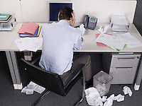 Stressed businessman at office desk