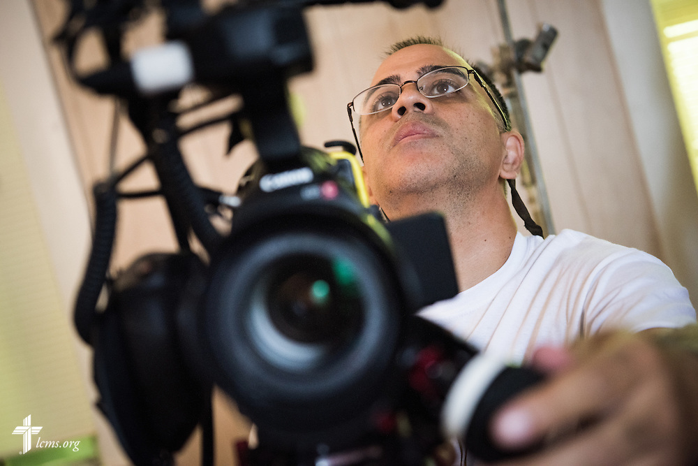 Ben DeSousa, director of photography, prepares the camera for a scene during filming of 'The First Rosa' documentary at Hope Lutheran Church on Wednesday, Sept. 24, 2014, near Selma, Ala. LCMS Communications/Erik M. Lunsford