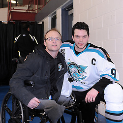 LINDSAY, ON - Feb 21 : Ontario Junior Hockey League Game Action between the Lindsay Muskies and the Pickering Panthers, Vince Herlihey #9 of the Lindsay Muskies Hockey Club with Gary Norris team supporter.<br /> (Photo by Andy Corneau / OJHL Images)