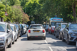 © Licensed to London News Pictures. 30/05/2020. London, UK. Cars queue up outside the gates of Richmond Park while members of the public go out in the sunshine during lockdown as weather experts predict another warm weekend with highs of 28c. On Monday, up to six people will be allowed to meet up in parks and private gardens. Photo credit: Alex Lentati/LNP