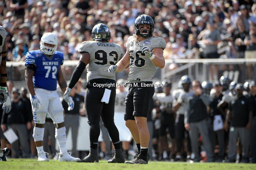 Central Florida linebacker Pat Jasinski (56) sets up for a play during the first half of the American Athletic Conference championship NCAA college football game against Memphis Saturday, Dec. 2, 2017, in Orlando, Fla. (Photo by Phelan M. Ebenhack)