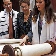 Parents with Bat Mitzvah girl reading from the Torah Scroll  .Ceremony admitting Jewish girl as an adult into Jewish Community, at age 13. <br /> <br /> Maya Gering - Bat Mitzvah - 11-15-03
