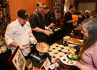 Brendan McGuff and Drake Cann from Lavinia's prepare pan seared scallops served with zucchini noodles, mushrooms, cherry tomatoes, red pepper in a fresh tomato sauce during the 26th annual Altrusa Taste of the Lakes Region at Church Landing Sunday evening.   (Karen Bobotas/for the Laconia Daily Sun)