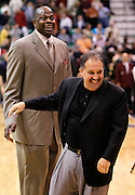 Orlando Magic head coach Stan Van Gundy, right, runs away from assistant coach Patrick Ewing, left, as they joke before their team's NBA basketball game against the Utah Jazz in Salt Lake City, Friday Dec. 10, 2010. (AP Photo/Colin E Braley)