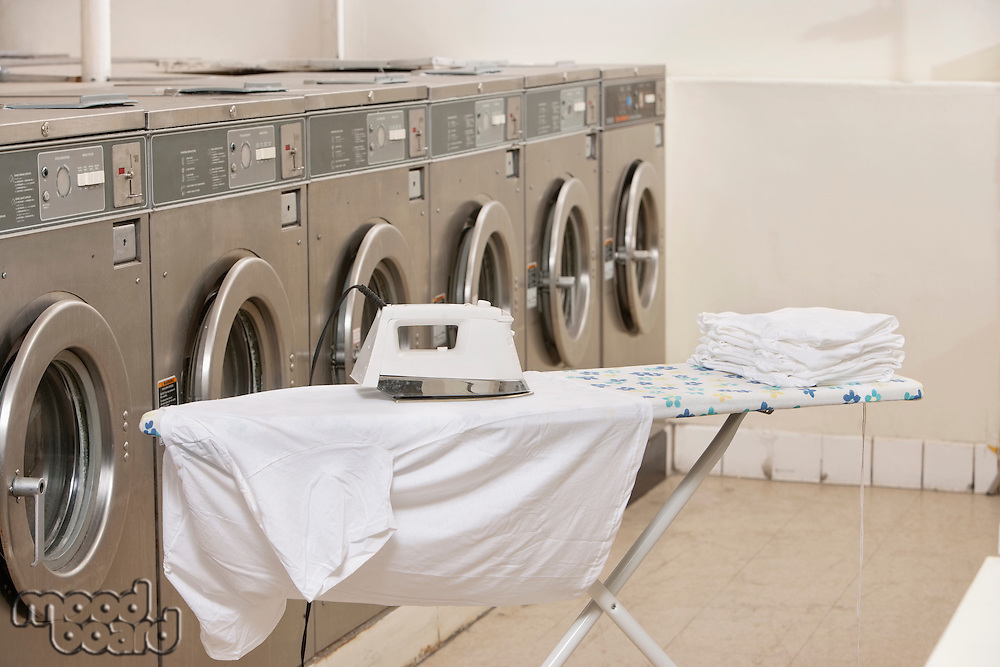 Ironing board with washing machines in Laundromat