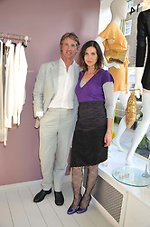 TAMSIN DE ROEMER and her husband JUSTIN PACKSHAW at a party at De Roemer, 14 Porchester Place, London W2 on 1st May 2013.