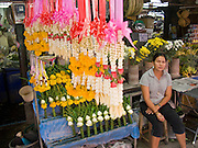 20 FEBRUARY 2008 -- KANCHANABURI, THAILAND: A flower garland vendor in the market in Kanchanaburi, Thailand.  Photo by Jack Kurtz