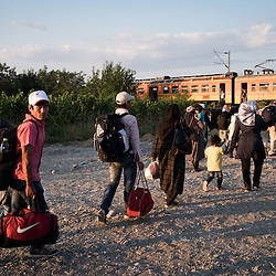 Refugees board a train to the Serbian border after crossing into Macedonia from Greece near Gevgelija.
