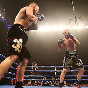 Sammy Vasquez, Jr. of Pennsylvania (camo trunks) beats Jay Krupp from New York, during the Iron Mike Productions,  ESPN Friday Night Fights boxing match at Turning Stone Resort Casino on Friday, June 6, 2014 in Verona, New York.  (AP Photo/Alex Menendez)