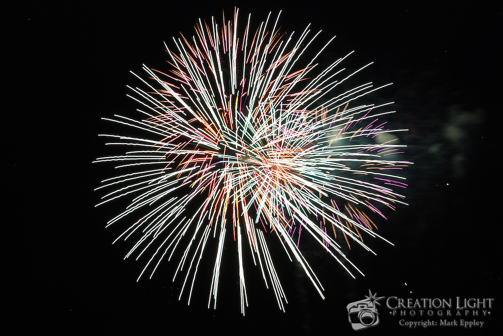 Fireworks provide amazing streaks of light.  Fireworks in Medford, Oregon on Indepedence Day