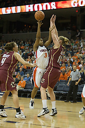 UVA's Paulisha Kellum gets a shot off over BC's Kathrin Ress (11).  The Cavaliers defeated the Eagles 65-63 in overtime at the John Paul Jones Arena in Charlottesville, VA on January 14, 2007.