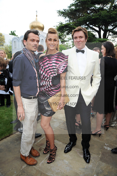 Left to right, MATTHEW WILLIAMSON, SIMON & YASMIN LE BON at the Raisa Gorbachev Foundation Party held at Stud House, Hampton Court Palace on 5th June 2010.  The night is in aid of the Raisa Gorbachev Foundation, an international fund fighting child cancer.