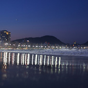 Praia de Copacabana at dusk. Copacabana beach, one of the world's most famous urban beaches at dusk. The beach and hotel strip stretches for 1.5 miles (4km) from the Morro do Leme at the Northern end, to Arpoador at the South. Copacabana beach, Rio de Janeiro,  Brazil. 12th August 2010. Photo Tim Clayton.