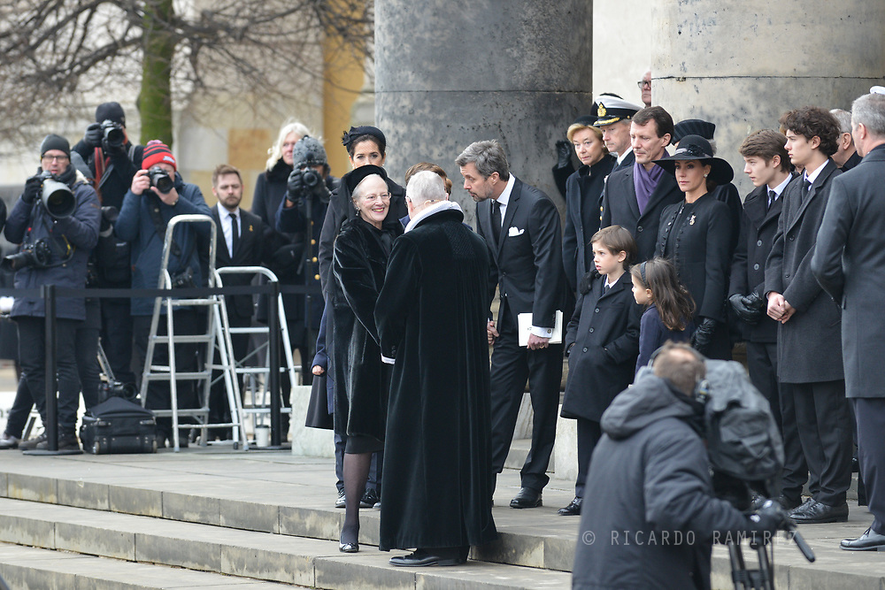20.02.2018. Copenhagen, Denmark. <br /> Queen Margrethe managed a smile as she thanked and shook hands withRoyal priest Erik Nordmand Svendsen after the funeral service before it leaves the church.<br /> Photo: Ricardo Ramirez.
