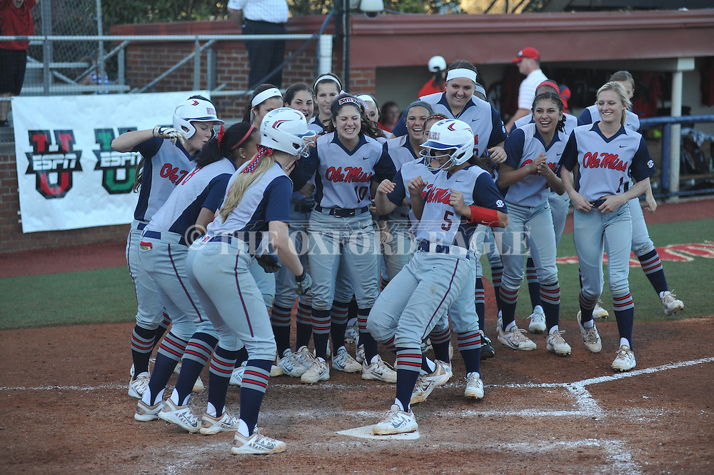 Ole Miss' Madi Osias (5) hits a solo home run vs. Auburn in college softball action in Oxford, Miss. on Sunday, March 15, 2015. Auburn won 7-3.