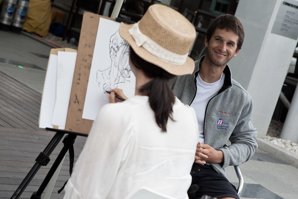 Mathieu Richard gets his protrait sketched while being interviewed by a television crew at the 2011 Korea Match Cup. Gyeonggi Province, Korea. 10 June 2011. Photo: Subzero Images/Korea Match Cup