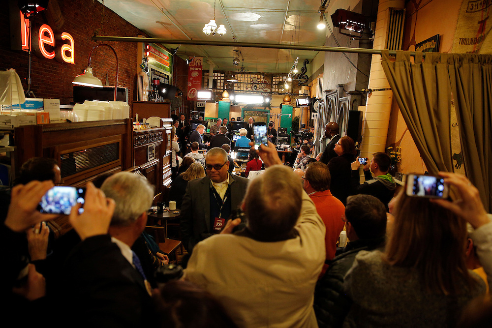 Audience members take photos of Republican U.S. presidential candidate Donald Trump during an appearance on MSNBC's Morning Joe cable television show at Java Joe's CoffeeHouse in Des Moines, Iowa, January 15, 2016. REUTERS/Scott Morgan