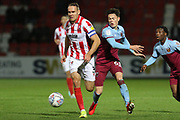 Chris Hussey and Anthony Scully  during the leasing.com EFL Trophy match between Cheltenham Town and U21 West Ham United at Jonny Rocks Stadium, Cheltenham, England on 8 October 2019.