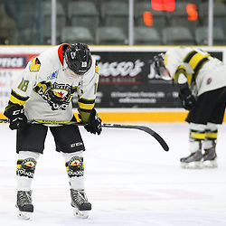 TRENTON, ON  - MAY 5,  2017: Canadian Junior Hockey League, Central Canadian Jr. &quot;A&quot; Championship. The Dudley Hewitt Cup Game 7 between Georgetown Raiders and the Powassan Voodoos.    Brett Hahkala #18 of the Powassan Voodoos hunches over post game.<br /> (Photo by Alex D'Addese / OJHL Images)