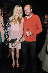 NOELLE RENO and SCOT YOUNG at the launch of Beulah's collaboration with Hennessy Gold Cup and a preview of the SS13 Collection held at The Brompton Club, 92b Old Brompton Road, London SW7 on 18th October 2012.