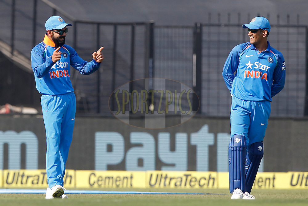 Virat Kohli Captain of India and MS Dhoni of India during the third One Day International (ODI) between India and England  held at Eden Gardens in Kolkata on the 22nd January 2017<br /> <br /> Photo by: Deepak Malik/ BCCI/ SPORTZPICS