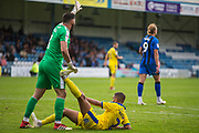 Tom King (GK) (Wimbledon) sorting out the cramp experienced by Tennai Watson (Wimbledon) during the EFL Sky Bet League 1 match between Gillingham and AFC Wimbledon at the MEMS Priestfield Stadium, Gillingham, England on 8 September 2018.