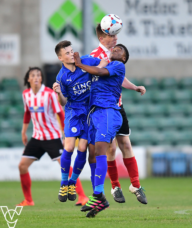 Lincoln City&rsquo;s Luke Anderson vies for possession with Leicester City&rsquo;s Conor Tee, left, and Leicester City&rsquo;s Khanya Leshabela<br /> <br /> Lincoln City under 18s Vs Leicester City under 18s at Sincil Bank, Lincoln.<br /> <br /> Picture: Chris Vaughan/Chris Vaughan Photography<br /> <br /> Date: July 28, 2016
