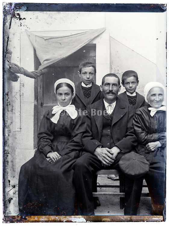 three generation rural farmer family portrait France early 1900s