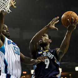 April 1, 2011; New Orleans, LA, USA; New Orleans Hornets center Emeka Okafor (50) defends against Memphis Grizzlies shooting guard Tony Allen (9)during the first quarter at the New Orleans Arena.    Mandatory Credit: Derick E. Hingle