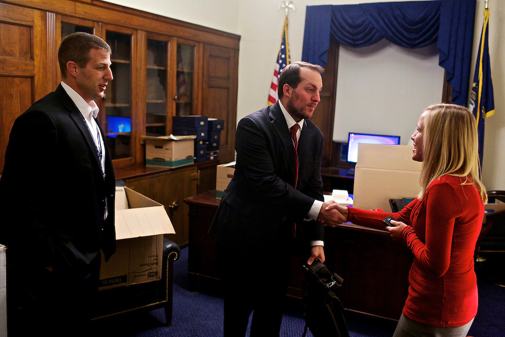 Congressman-elect Markwayne Mullin, from Oklahoma's 2nd District, left, makes decisions about his future office with his advisor Trebor Worthen, right, and another congress staffer, right, in the Longworth House Office Building in Washington, DC on Nov. 29, 2012.