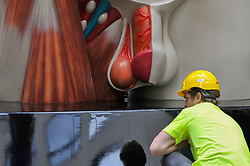 "© Licensed to London News Pictures. 24/06/2017. London, UK. Workmen install a 21 feet tall, 2.5 tonne bronze sculpture called ""Temple"" by Damien Hirst near the Lloyds Building in the City of London.  The artwork will be on display as part of ""Sculpture in the City"", a festival of sculpture in the City of London showing works by leading artists. Photo credit : Stephen Chung/LNP"