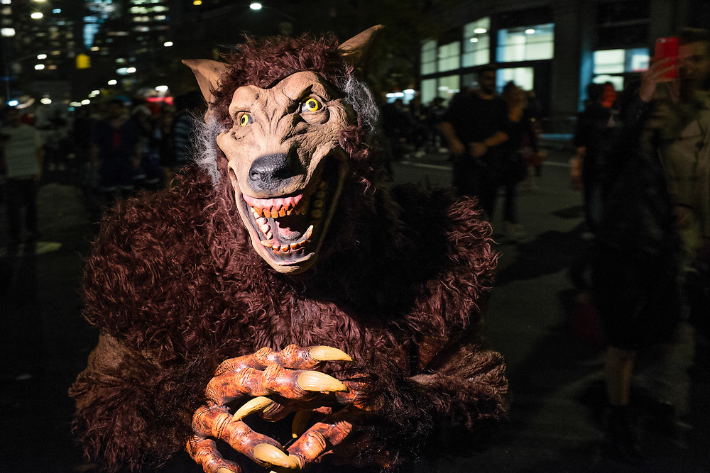 New York, NY - 31 October 2019. the annual Greenwich Village Halloween Parade along Manhattan's 6th Avenue. A scary beast costume.
