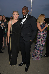 SOL CAMPBELL and his wife FIONA BARRATT at the Chovgan Twilight Polo Gala in association with the PNN Group held at Ham Polo Club, Petersham Close, Richmond, Surrey on 10th September 2014.