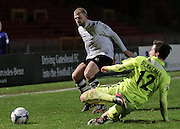Adam Blakeman (Southport) slides in to clear the ball as Craig Baxter (Gateshead) looks on during the Vanarama National League match between Gateshead and Southport at Gateshead International Stadium, Gateshead, United Kingdom on 8 December 2015. Photo by Mark P Doherty.