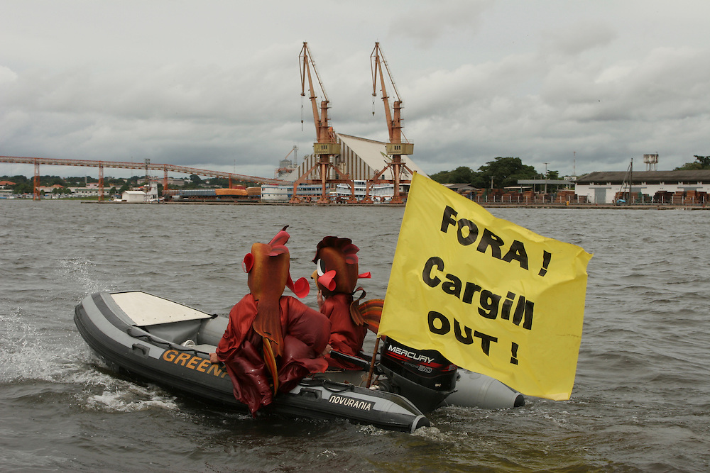 May 18th 2006. Santarem (Para State, Brazil)..Activists from the MY Arctic Sunrise deployed a banner in front of Cargill soy facility in Santarem. Two of them were dressed as chickens, protesting the use of Amazon Soya by fast food chains like Kentucky Fried Chicken...©Daniel Beltra