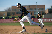 Greece Athena first baseman Jake Kimble races the runner to the bag after fielding a grounder during a game in Hilton on Wednesday, April 27, 2016.