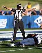 An NFL official rules incomplete pass during the Dallas Cowboys 2016 NFL preseason football game against the Los Angeles Rams on Saturday, Aug. 13, 2016 in Los Angeles. The Rams won the game 28-24. (©Paul Anthony Spinelli)