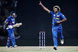 © Licensed to London News Pictures. 01/10/2012. Sri Lankan bowler Lasith Mailnga celebrates after getting a wicket during the T20 Cricket World super 8's match between England Vs Sri Lanka at the Pallekele International Stadium Cricket Stadium, Pallekele. Photo credit : Asanka Brendon Ratnayake/LNP