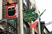 Signs outside Quays pub restaurant in Temple Bar area, Dublin city centre, Ireland, Republic of Ireland