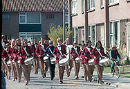 The Ammerstol Marching band Excelsior parading through the Snackertstraat in Ammerstol, 1980.